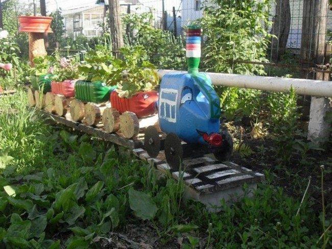 Клумбы из пластиковых бутылок своими руками фото